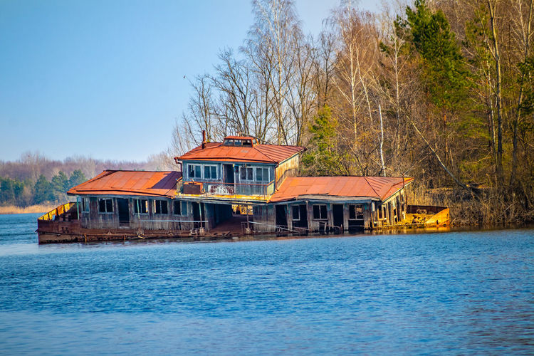 House by lake against building
