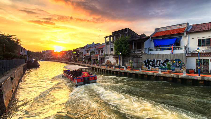 Water Sunset Architecture Sky Built Structure Building Exterior Transportation Nautical Vessel Cloud - Sky Nature Waterfront Mode Of Transportation River Building City Motion Incidental People Outdoors
