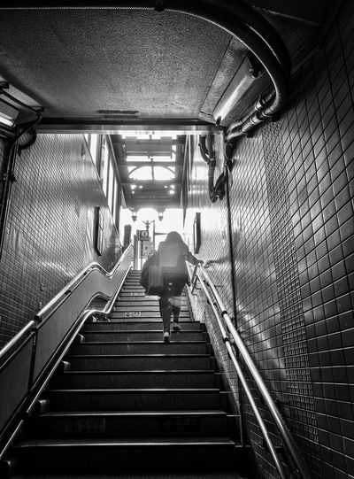 Rear view of woman walking on subway