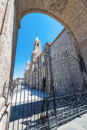 View of arch and gate blocking entrance to the cathedral in the historic center of Arequipa, Peru Andes Arch Architecture Architecture Arequipa Cathedral Catholic Catholicism Church City Colonial Colonial Architecture Gate Landmark Peru Plaza Plaza De Armas Sillar South America Stone Travel Destinations