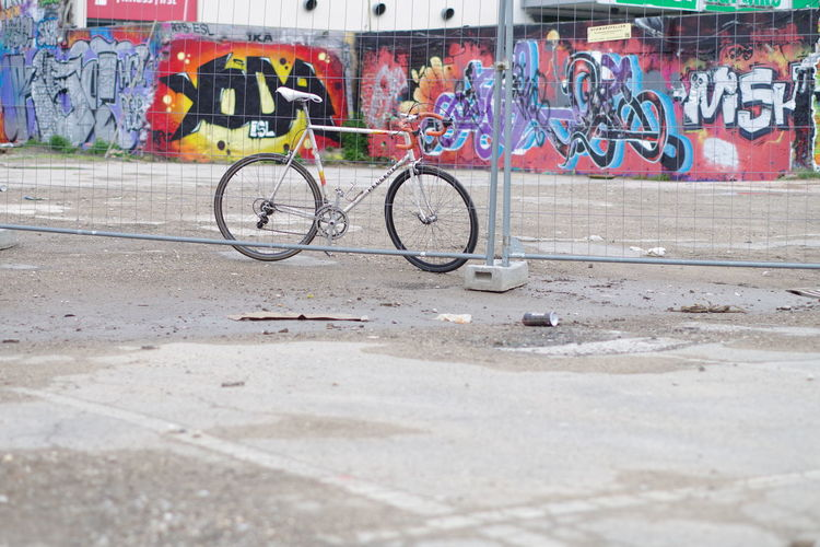Graffiti on bicycle parked on footpath