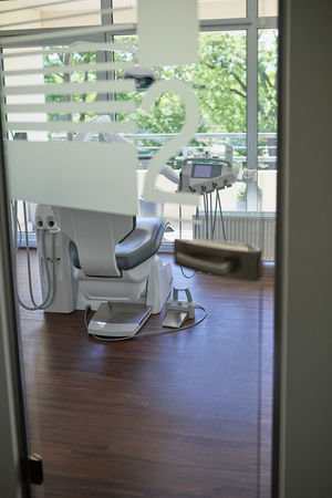 Dentist surgery room with empty chair Clinic Dentist Dentist Chair Door Empty Glass Door Hospital Light Modern No People Surgery Surgeryroom