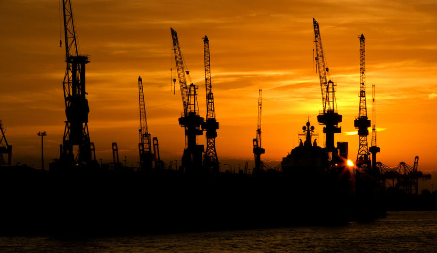 Sunset Sky Silhouette Orange Color Industry No People Machinery Cloud - Sky Crane - Construction Machinery Water Outdoors Transportation Nautical Vessel Beauty In Nature Mode Of Transportation Dusk