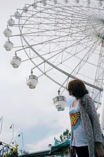 A merry ferris wheel we go round. Ferris Wheel Ferriswheel Game Amusement Park Sky Photography Wonder Woman The Week On EyeEm Moment Leisure Activity Vacations Nature Outdoors Cloudy Skies Daydream Childhood Thrill Tagaytay City