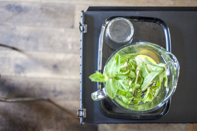 Directly above shot of mint leaves with lemon in jar