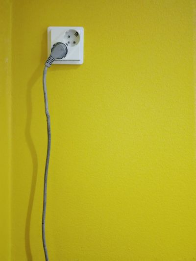 Yellow Yellow Wall Plug Socket Connection Electric Cord Electric Cable Color Wall Texture Background Electricity  Power Cable Indoors  No People Power Supply White No People