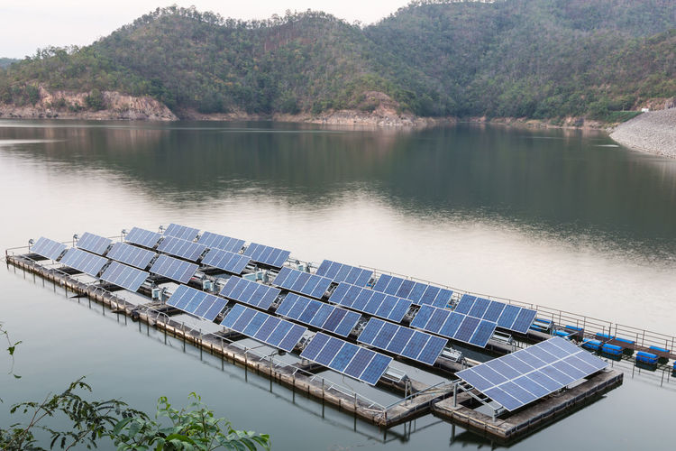 Scenic view of lake and solar panels