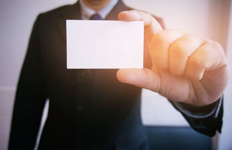 Cropped Image Of Businessman Holding Business Card