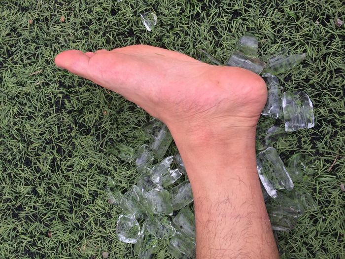 Football Chiangrai Thailand Soccer Field Ice Green Color Day Outdoors Low Section Human Body Part Grass Human Hand One Person Real People High Angle View Close-up People Foot
