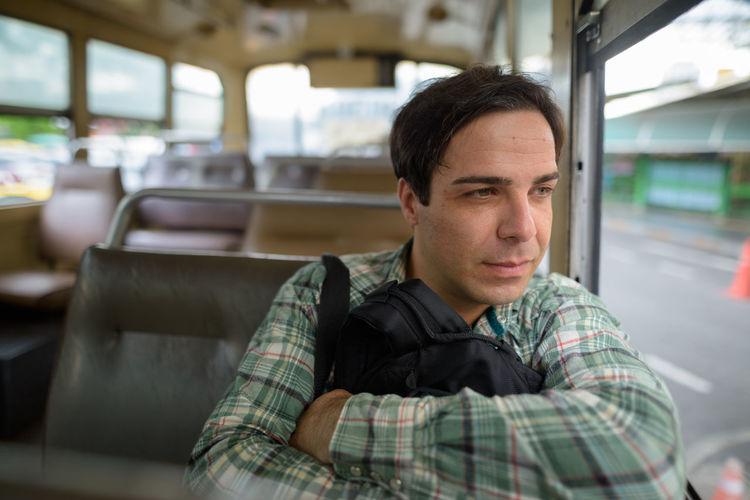 Man sitting in bus