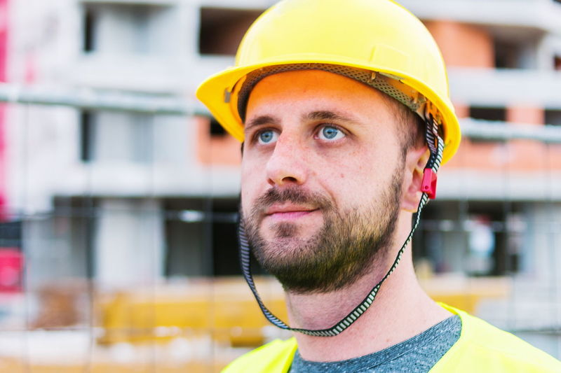 Close-Up Of Construction Worker Looking Away