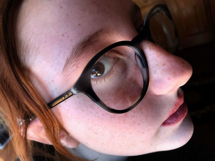 Close-up portrait of woman wearing eyeglasses