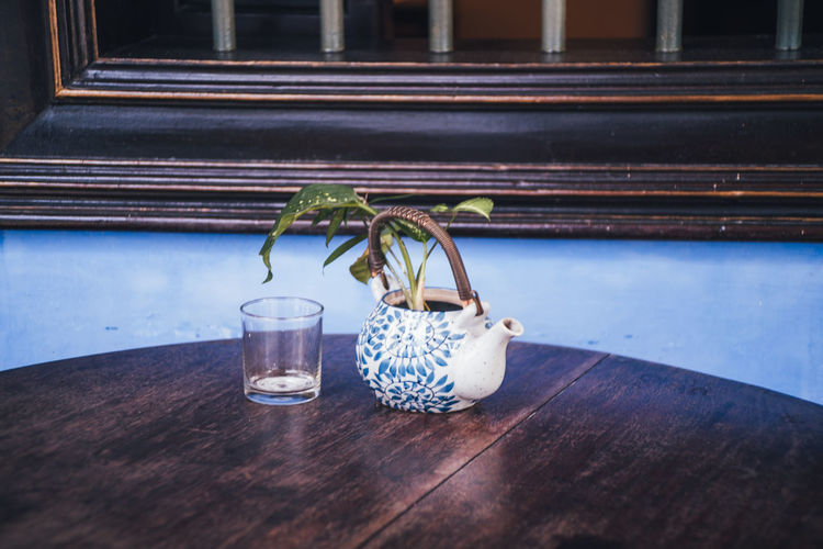 Table Wood - Material Indoors  No People Glass - Material Still Life Container Transparent Blue Food And Drink Close-up Freshness Nature Day Jar Home Interior Plant Drink Seat Luxury Indoors  Decor Decoration Art