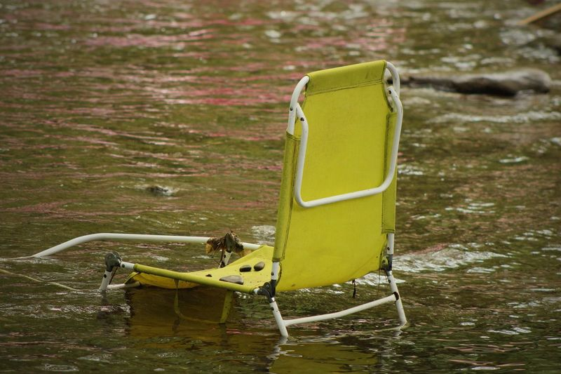 Abandoned lounge chair during flood