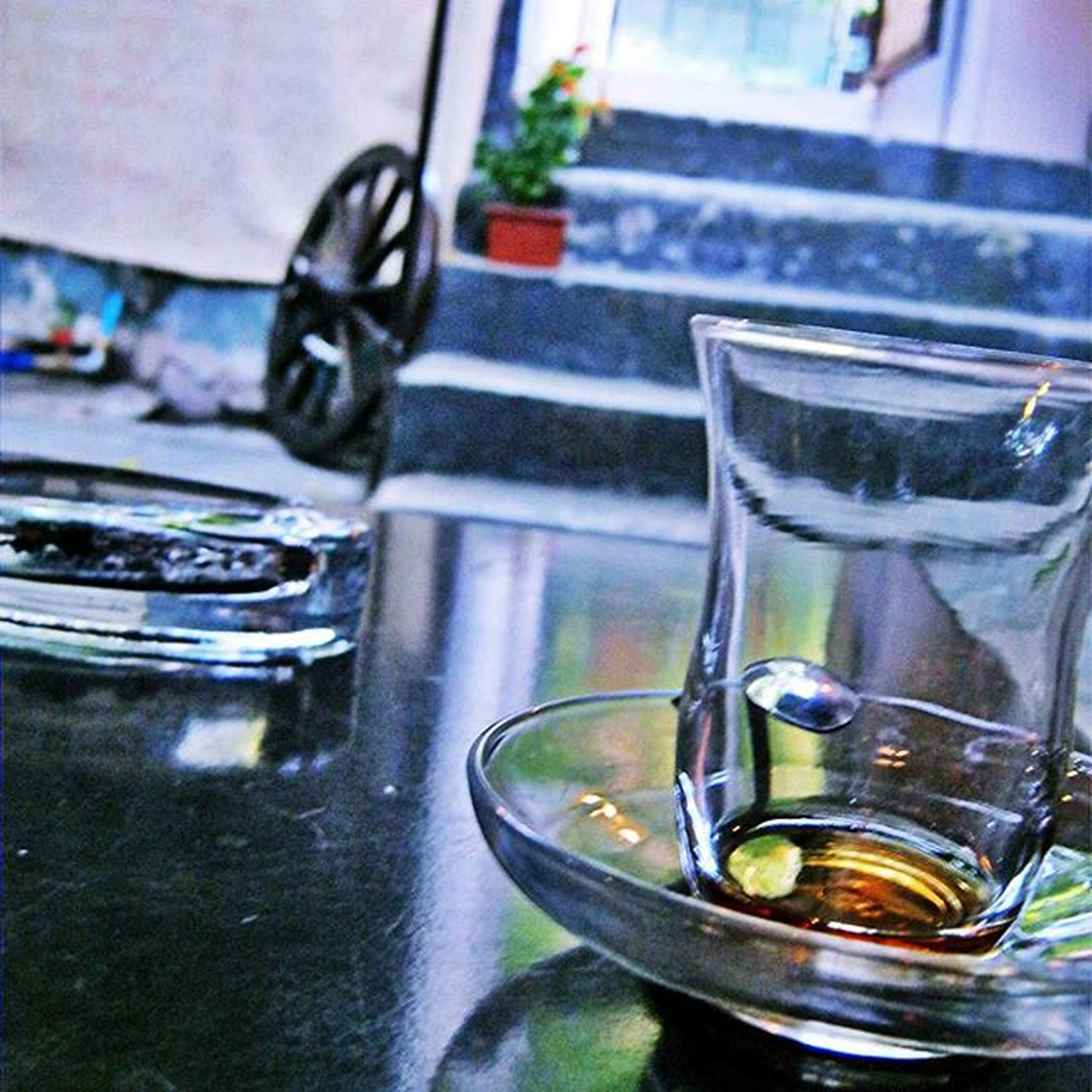 glass - material, close-up, focus on foreground, indoors, transparent, reflection, table, still life, water, drinking glass, no people, glass, refreshment, day, drop, drink, window, wet, green color, freshness