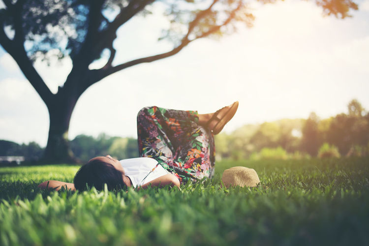 Surface level view of woman lying at park