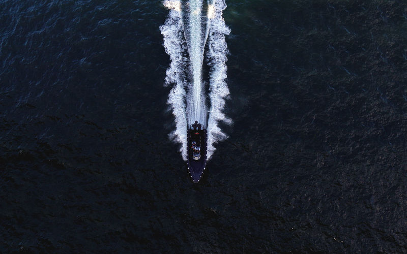 A minimalism of water vessel from above From Above  Speed Boat Beauty In Nature Cold Temperature Day Dinghy Directly Above Frozen High Angle View Ice Icicle Minimal Minimalism Motion Nature No People Outdoors Rib Speed Sport Vessel Wake - Water Water Waterfront Winter
