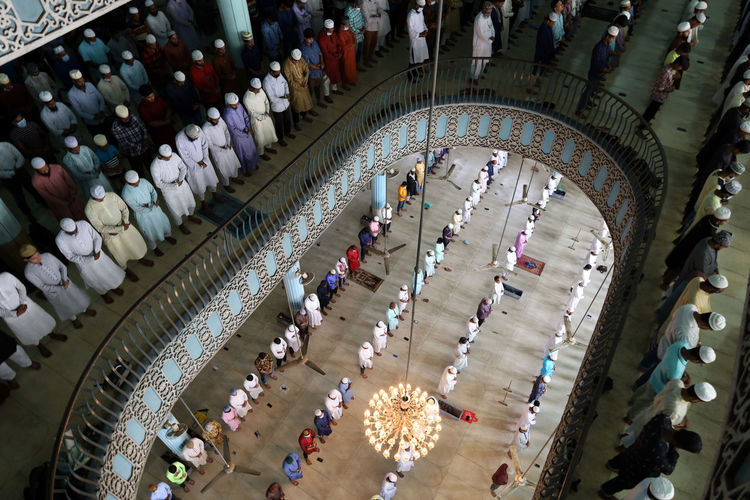 High angle view of people praying in mosque