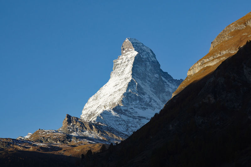 Low angle view of matterhorn mountain against clear sky