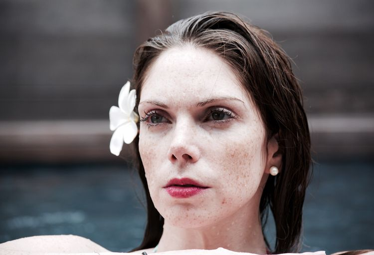 Close-up portrait of  woman in swimming pool