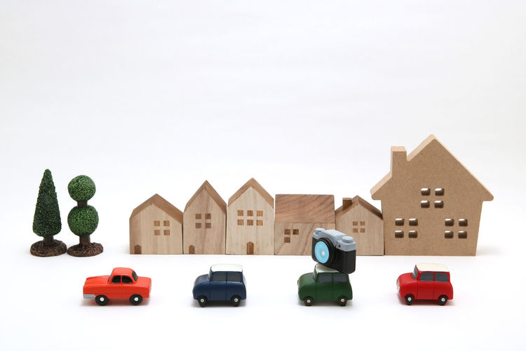 Toy car against white background
