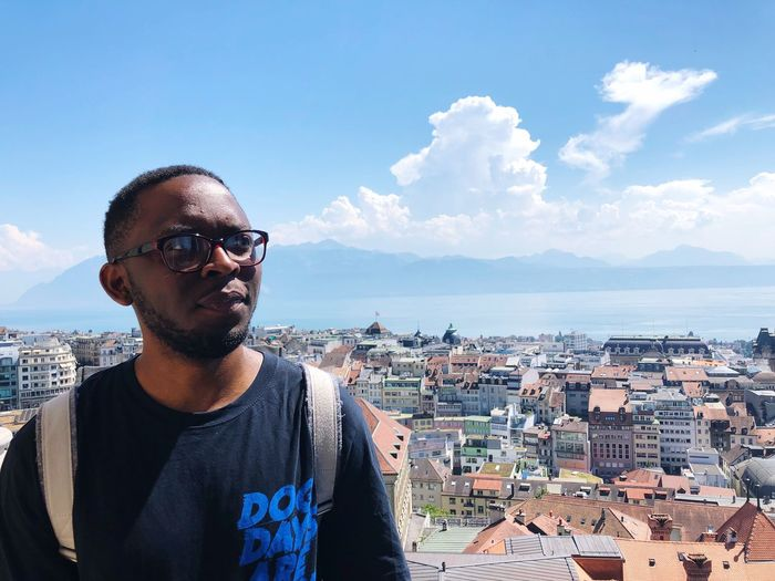 Favourite tourist EyeEmNewHere EyeEm Best Shots Switzerland Lausanne Lac Léman Cathederal EyeEm Selects Sky One Person Real People Architecture Built Structure Building Exterior Lifestyles Cloud - Sky Leisure Activity Nature Glasses Young Men City Men Front View Sunglasses Casual Clothing Sea Water Day The Traveler - 2018 EyeEm Awards
