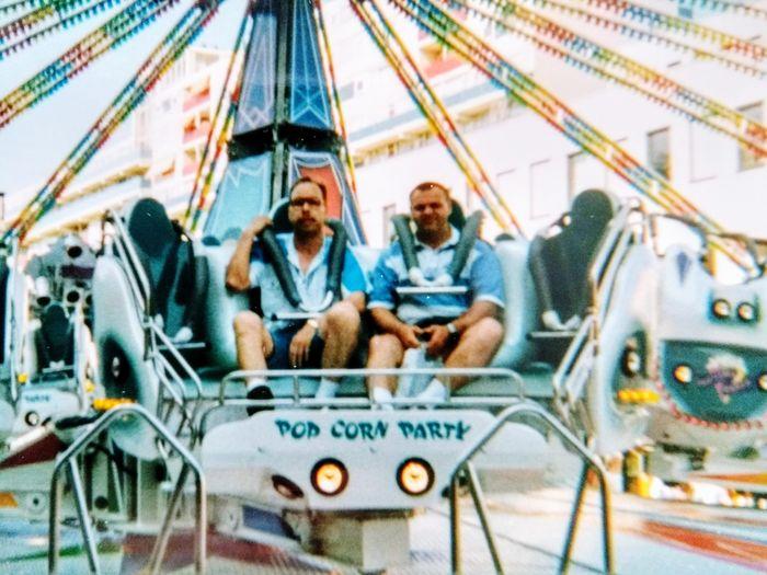 People sitting in amusement park