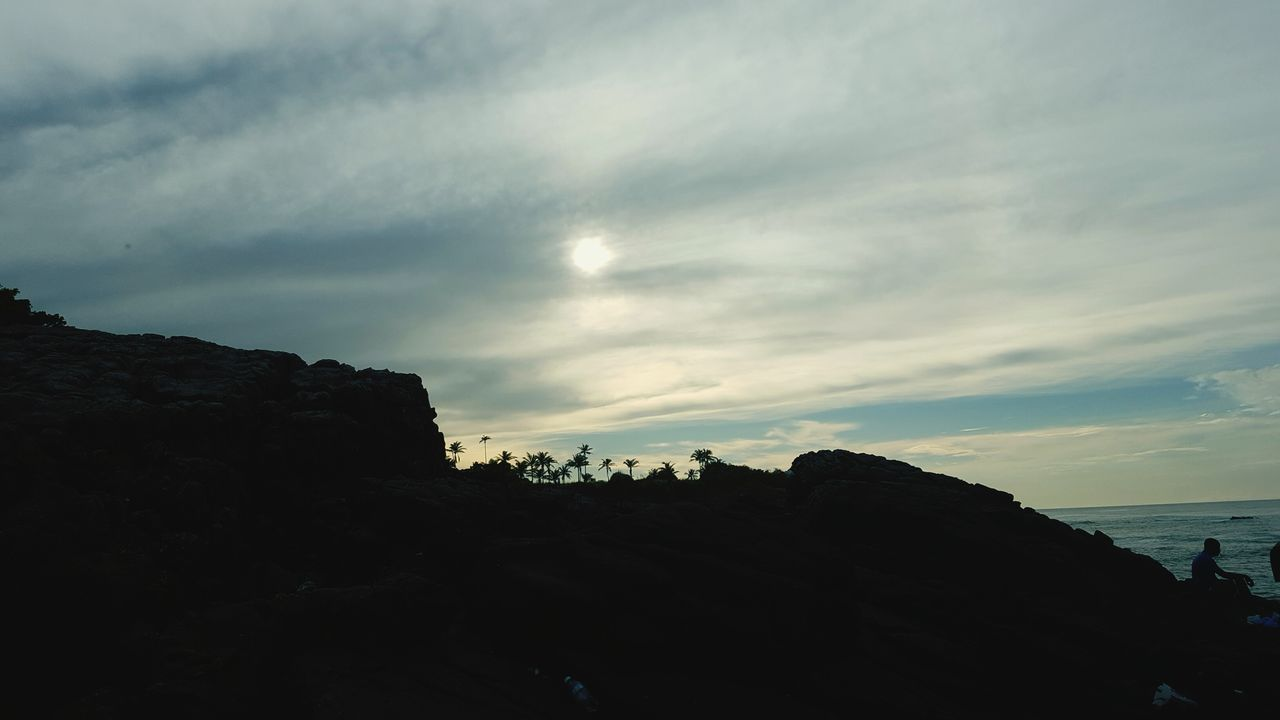 sky, nature, rock formation, rock - object, scenics, cliff, beauty in nature, sea, tranquility, cloud - sky, outdoors, water, no people, day