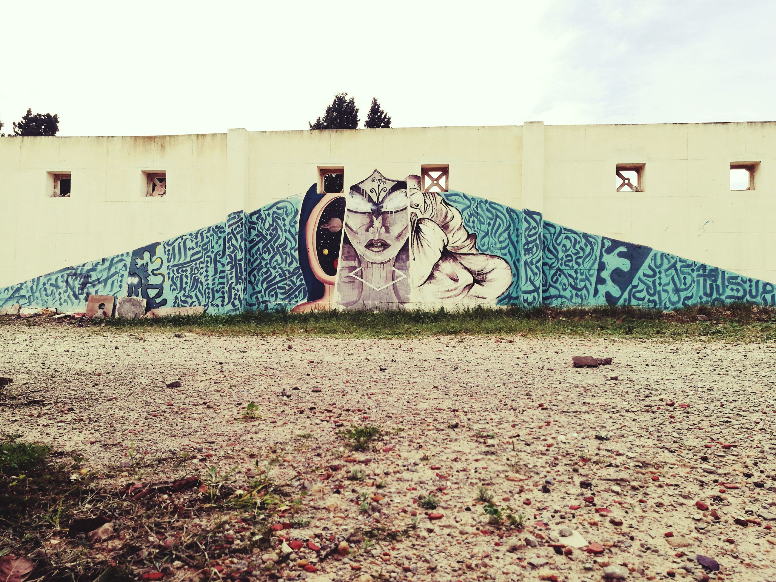 graffiti, creativity, text, day, built structure, sky, no people, outdoors, architecture
