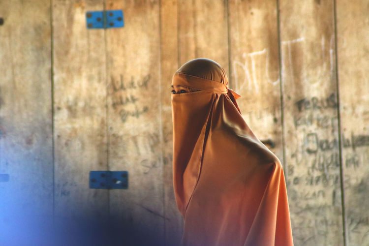A muslim woman who wears a veil
