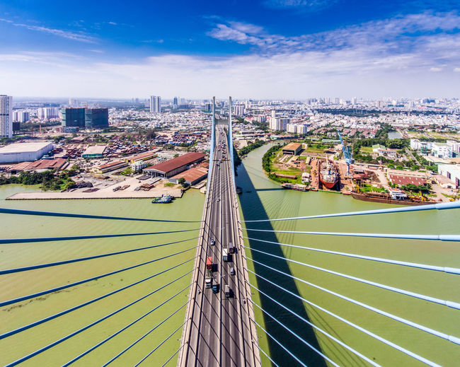 High angle view of phu my bridge over river in city against sky