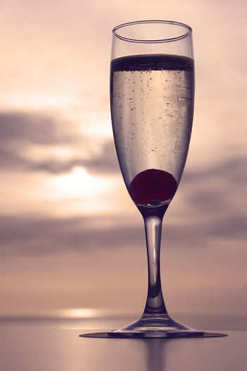 Cava champagne with cherry at sunset