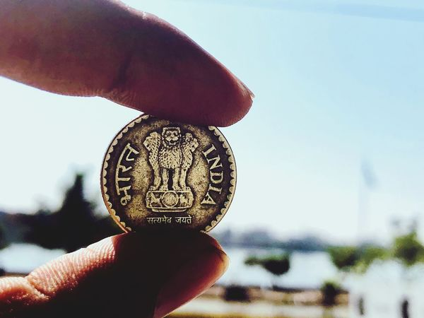 Satyamev jayte.. The Coin says . India. EyEm Selects Detailed Visionary Gold 5 Rupees Truth Slogan India Coin Holding