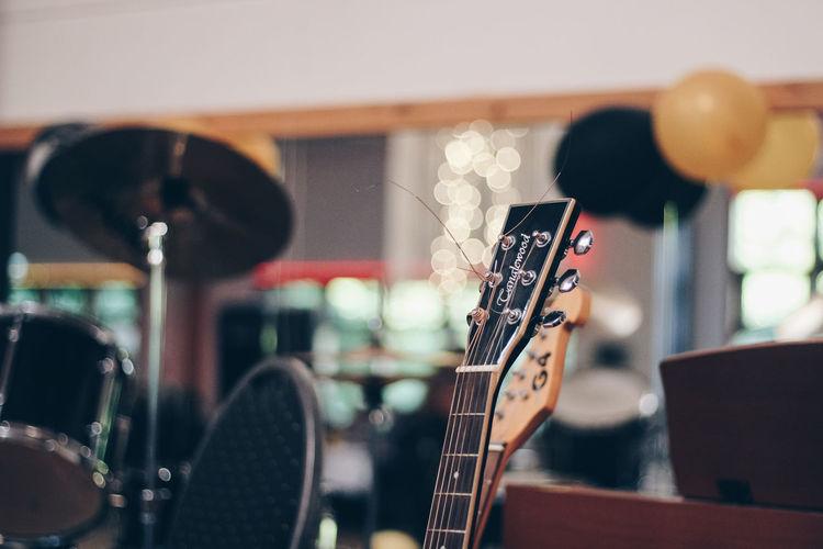 Close-up of playing guitar