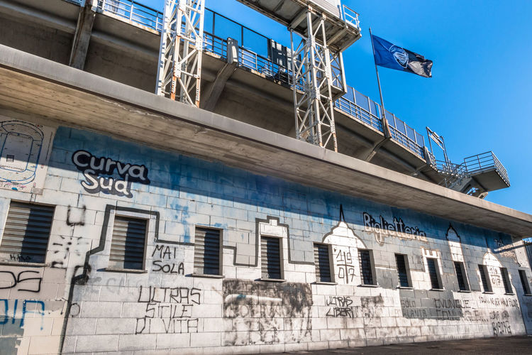 Europe Italy Outdoor Action Architecture Atalanta Azzurri Background Bergamo Billboard Blue Building Business Competition Crowd Editorial  Exterior Fans Football Game Gathering Glag  Goal Graffiti Gray Grey Italian Match Milan Office Old People Players Red Sky Soccer Sport Stadium SUPPORT Symbol Team Text Ticket Town Tribune Wall White