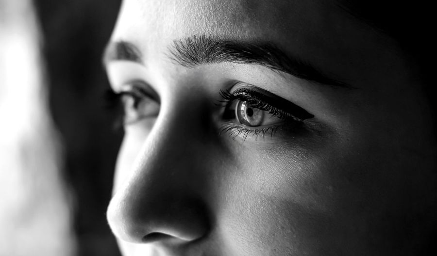 Human Body Part Portrait Human Face One Person Young Adult Looking Adult Human Eye Close-up Eye Body Part Emotion Indoors  Contemplation Headshot Women Looking Away Eyebrow Black Background Depression - Sadness