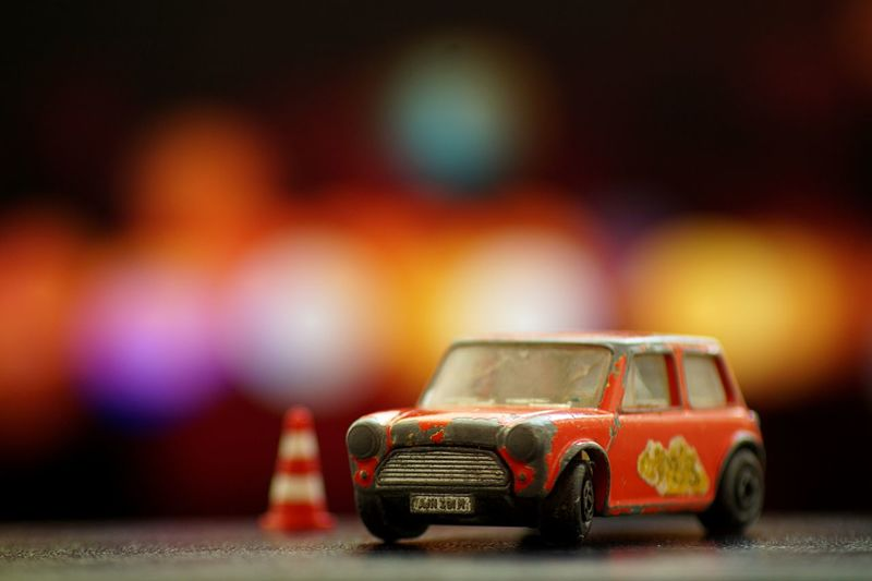 old toy car Mini Car Childhood Close-up Copy Space Focus On Foreground Fun Indoors  Mode Of Transportation Motor Vehicle Offspring People Racecar Red Selective Focus Taxi Toy Toy Car Transportation