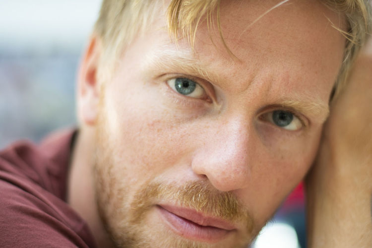 Front view of young man looking directly into the camera. Adult Blue Eyes Hair Man Adult Blond Hair Body Part Close-up Day Emotion Eye Focus On Foreground Front View Guy Hair Human Face Looking At Camera Men One Person Portrait Red Beard Young Adult