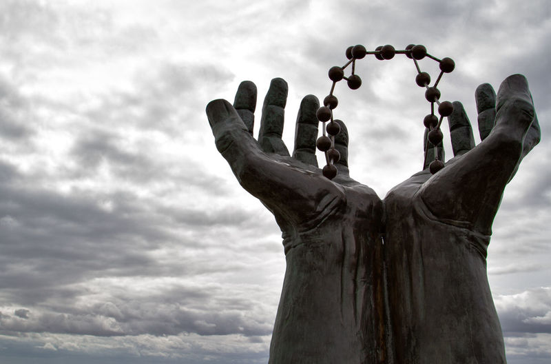 reach for the sky Art Cloud - Sky Cloudy Creativity Creativity Darkness And Light Day Detail Focus On Foreground Hands Light Limb Low Angle View Memories No People Outdoors Person Sculpture Sky Statue