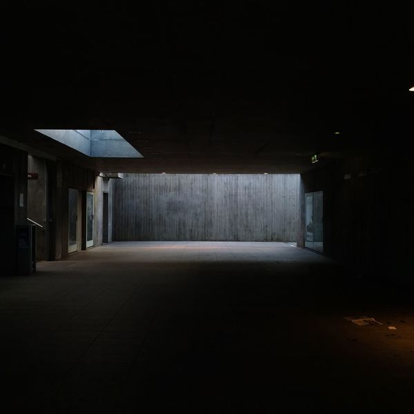 Absence Architectural Column Architecture Building Built Structure Ceiling Concrete Dark Direction Domestic Room Empty Entrance Garage Illuminated Indoors  Lighting Equipment Night No People Parking Garage Parking Lot Spooky The Way Forward Transportation Wall - Building Feature