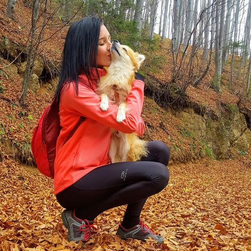 love him Pet Owner Love Pomeranian Tree Sitting Full Length Red Women Young Women Crouching Sky Casual Clothing Pets Domestic Animals Dog Canine