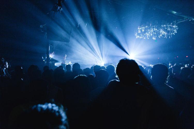 Silhouette people enjoying music concert