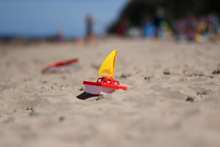 Beach Life Beach Photography Beach Beachphotography Boat Childhood Close-up Day Focus On Foreground Incidental People Land Nature Outdoors Plastic Sand Sandy Beach Selective Focus Sky Still Life Sunlight Surface Level Toy Toy Boat Toy Boats Transportation