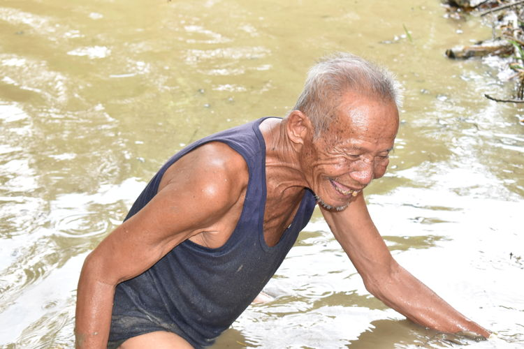 High angle view of senior man in swimming pool