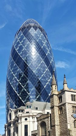 Old vs New... Architecture Building Exterior Dome Low Angle View Sky Blue Sky Gherkin Tower Gherkin Building Church Old Building  Modern Building London City Urban City Skyline Skyscraper Urban Skyline London Architecture The Architect - 2017 EyeEm Awards EyeEm LOST IN London