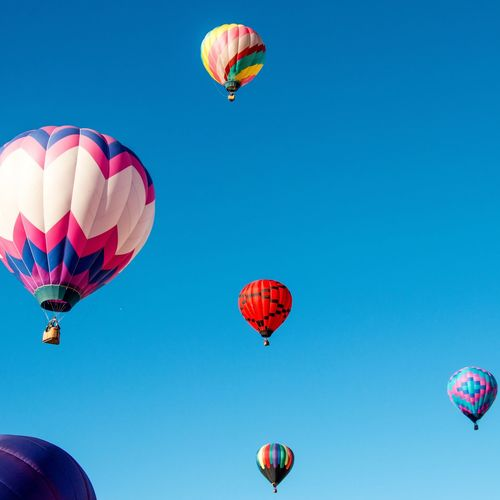 Low Angle View Of Colorful Hot Air Balloons Against Sky