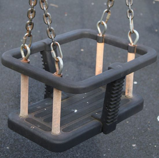 Chain Chain. Childs Playground Swing. Childs Swing. Close-up Design Empty Man Made Object Metal Chain. Metallic No People Outdoors Rubber Seat. Safety Seat. Still Life