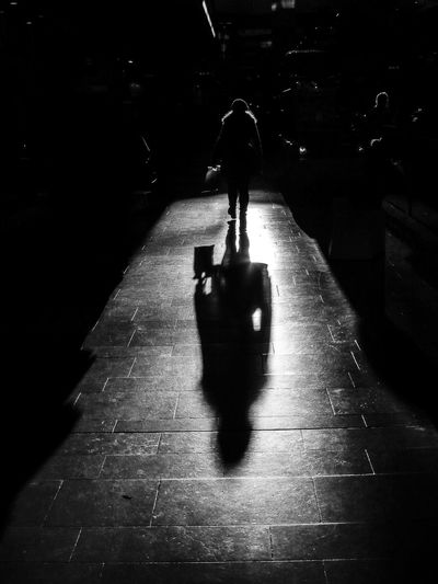 A shadow in a shopping mall in Stockholm. Walking Real People Architecture Luggage Direction City Shadow Travel Full Length Silhouette Men One Person The Way Forward Rear View Unrecognizable Person Transportation Lifestyles Indoors  Dark Flooring Stockholm Shopping Mall Blackandwhite