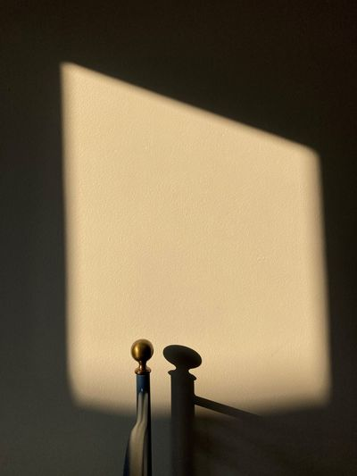 Close-up of lamp against wall