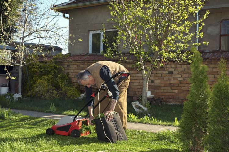 Man mowing at yard
